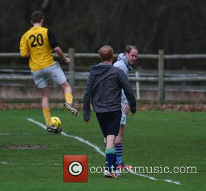 Prince Harry , Prince William - Princes William and Harry play football for the Sandringham estate team at Castle Rising...