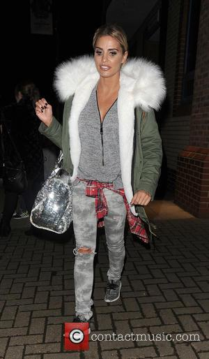 Katie Price - Katie Price leaves the New Woking Theatre with co-star Carla Nella having both appeared in a performance...