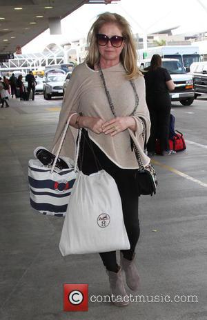 Kathy Hilton - Kathy Hilton departs on a flight from Los Angeles International Airport (LAX) carrying her Nike sneakers in...