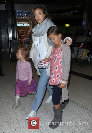 Jessica Alba, Honor Marie Warren , Haven Garner Warren - Jessica Alba and Cash Warren arrive at Los Angeles International...