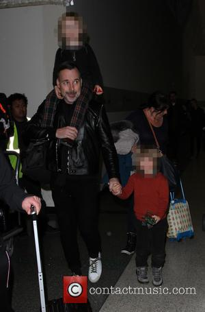 David Furnish, Zachary Jackson Levon Furnish-John , Elijah Joseph Daniel Furnish-John - David Furnish departs on a flight from Los...