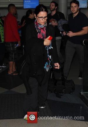 Julia Louis-Dreyfus - Julia Louis-Dreyfus arrives at Los Angeles International (LAX) Airport - Los Angeles, California, United States - Monday...
