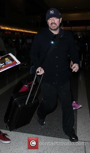 Ricky Gervais - Ricky Gervais arrives on a flight to Los Angeles International Airport (LAX) - Los Angeles, California, United...