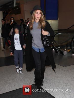 Elizabeth Gutiérrez , Christopher Alexander Levy - William Levy arrives at Los Angeles International Airport (LAX) with Elizabeth Gutierrez and...