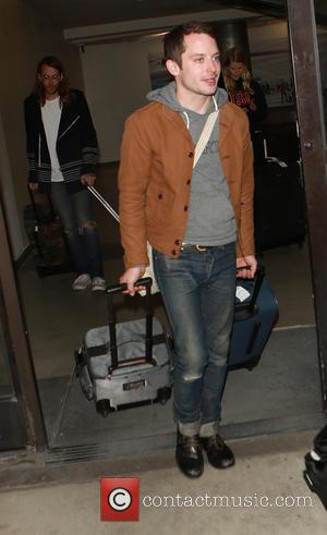 Elijah Wood - Elijah Wood arrives on a flight to Los Angeles International Airport (LAX) - Los Angeles, California, United...