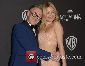 Alan Cumming and Kate Hudson