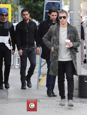 Wilmer Valderrama, Joe Jonas , Nick Jonas - The Jonas Brothers out and about getting a coffee with Wilmer Valderrama...