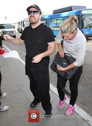 Ricky Gervais , Jane Fallon - Ricky Gervais departs on a flight from Los Angeles International Airport (LAX) with girlfriend...