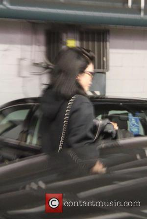 Kylie Jenner - Tyga and Kylie Jenner spotted leaving seperately from a building in Beverly Hills at beverly hills -...