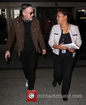 David Furnish - David Furnish arrives at Los Angeles International (LAX) Airport - Los Angeles, California, United States - Tuesday...