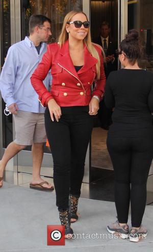 Mariah Carey - Mariah Carey wearing a bright red jacket and sky high heels, goes shopping at Van Cleef &...