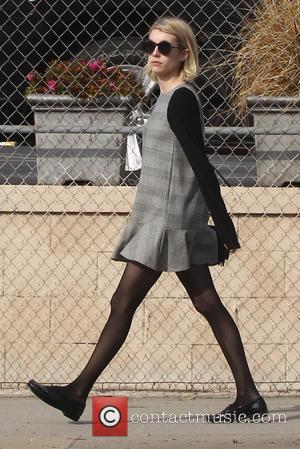 Emma Roberts - Emma Roberts out and about in West Hollywood wearing a grey smock dress and black stocking tights...