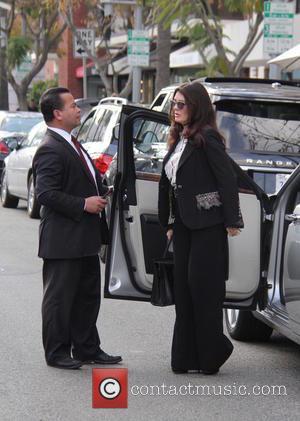 Lisa Vanderpump - Lisa Vanderpump sticks out her tongue as she arrives at Villa Blanca Restaurant in Beverly Hills. The...