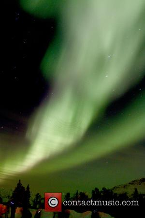Atmosphere - Aurora Borealis, more commonly known as the Northern Lights, seen over the Arctic Circle from a plane and...