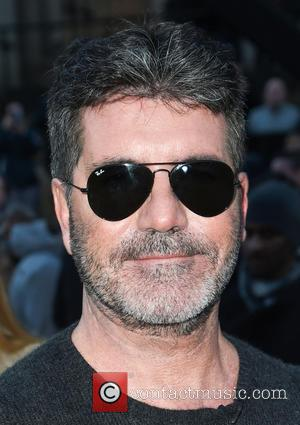 Simon Cowell Donates Funds To Young Cancer Patient