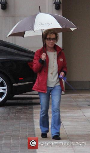 Judge Judy , Judith Sheindlin - Judge Judy shelters under an umbrella while out walking her dog in Beverly Hills...
