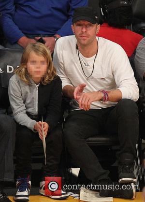 Chris Martin , Moses Martin - Chris Martin and his son Moses Martin watch the Sacramento Kings defeat the Los...