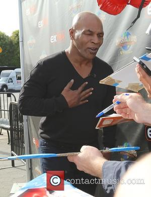 Mike Tyson - Celebrities at Universal Studios Hollywood for an appearance on 'Extra' in Universal City at Universal Studios Hollywood...