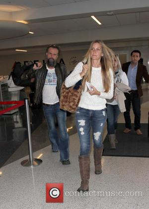 Rob Zombie , Sheri Moon Zombie - Rob Zombie and his wife Sheri Moon Zombie arrive at Los Angeles International...