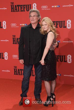 Kurt Russell and Jennifer Jason Leigh