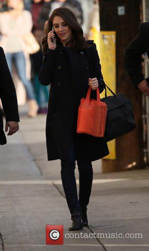 Alison Brie - Alison Brie talks on her cell phone as she arrives at the ABC studios for Jimmy Kimmel...