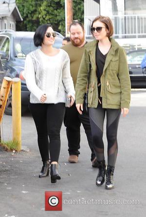 Lily Collins , Demi Lovato - Lily Collins and Demi Lovato leaving La Conversation after lunching together - Los Angeles,...