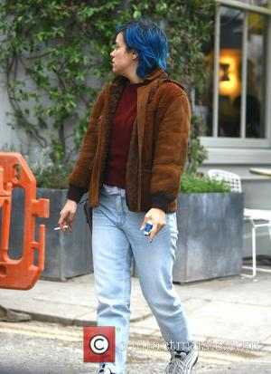 Lily Allen - A blue-haired Lily Allen smokes a cigarette on her way to a hairdressers in Notting Hill, accompanied...