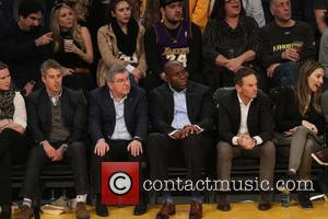Magic Johnson and Thomas Bach