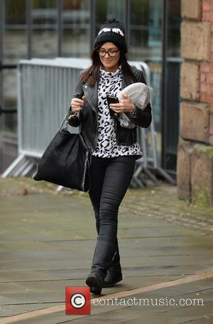 Kym Marsh - Kym Marsh leaves Key 103 Radio Station carrying a plate under her arm after co-presenting the breakfast...