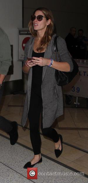Ashley Greene , Paul Khoury - Ashley Greene arrives on a flight to Los Angeles International Airport (LAX) with boyfriend...