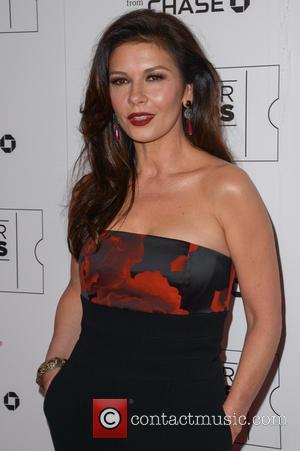 Catherine Zeta-Jones Shares Sweet Snap Of Family Cuddling Up At Christmas