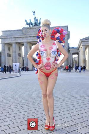Micaela Schäfer - Micaela Schaefer posing in a body painting outfit for a Valentine's Day themed photo shoot outside Brandenburg...