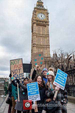 View - Junior doctors and their supporters protesting outside the Houses of Parliament during the Junior Doctors Strike. at Houses...