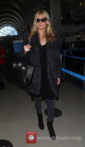 Heidi Klum - Heidi Klum arrives on a flight to Los Angeles International Airport (LAX) - Los Angeles, California, United...