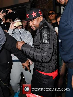 Floyd Mayweather Jr. - Floyd Mayweather Jr. is mobbed by fans after a personal appearance at Bar Sport in Cannock...