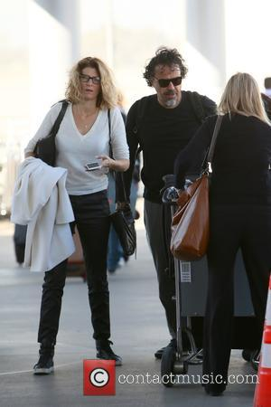 Alejandro Gonzalez Inarritu , Maria Eladia Hagerman - 'The Revenant' director Alejandro González Iñárritu arrives at Los Angeles International Airport...