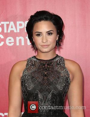 Demi Lovato Adopts Cat Despite Allergies