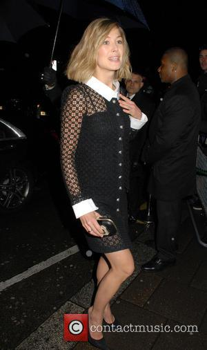 Rosamund Pike - The Charles Finch & Chanel Pre-BAFTAs Dinner at Annabel's - Outside Arrivals at BAFTAS - London, United...