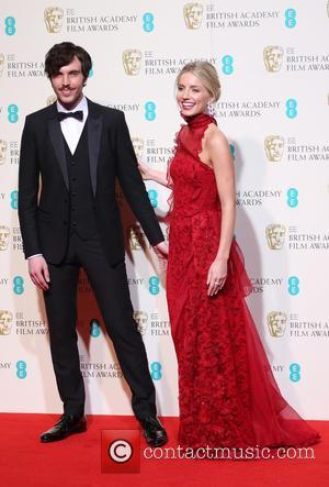 Annabelle Wallis and Tom Hughes
