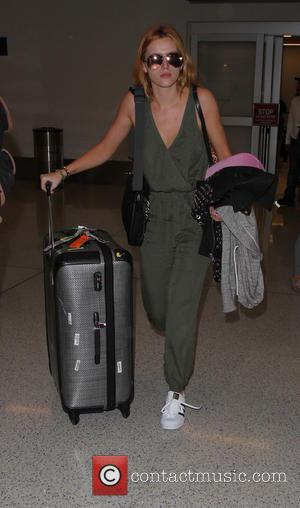 Bella Thorne - Bella Thorne arrives on a flight to Los Angeles International Airport (LAX) - Los Angeles, California, United...