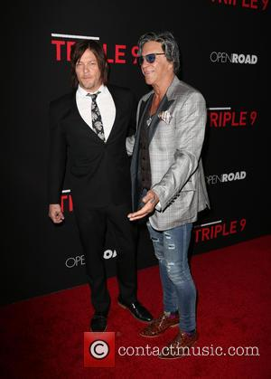 Norman Reedus , Mickey Rourke - Premiere Of Open Road's 'Triple 9' at Regal Cinemas L.A. Live - Arrivals at...