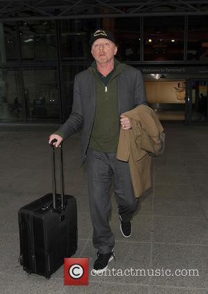 Boris Becker - Boris Becker looks rather tired and puffy faced, as he limps through Heathrow Airport. It was unclear...