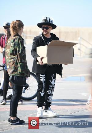 Boy George - Brooke Burke and Leila Ali do an event at Hermosa Beach - Los Angeles, California, United States...