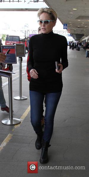 Sharon Stone, Roan Joseph Bronstein, Quinn Kelly Stone , Laird Vonne Stone - Sharon Stone arrives on a flight to...