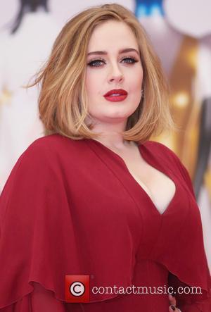 Adele 'To Take Five-year Break'