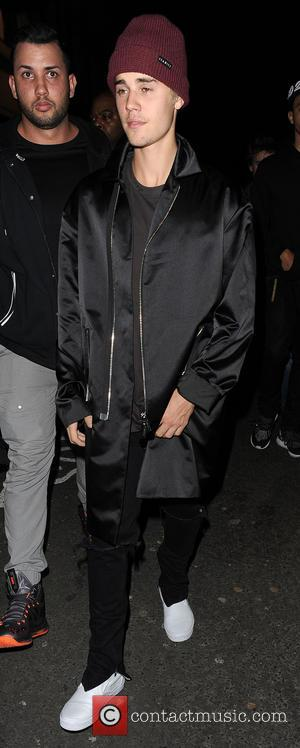 Justin Bieber - Justin Bieber makes an impromptu visit to 'The Crobar' pub in Soho, with a group of friends....