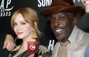 Christina Hendricks and Michael K. Williams