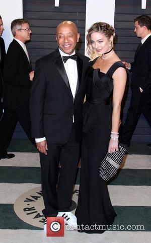 Russell Simmons , Lucy McIntosh - Vanity Fair Oscar Party 2016 held at the Wallis Annenberg Center for the Performing...