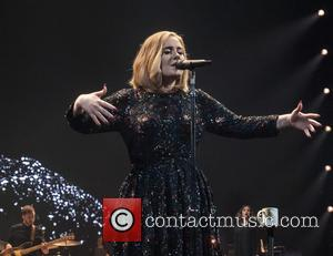 Adele Surprises Manchester Superfan With Signed Merchandise