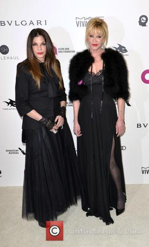 Melanie Griffith and Guest